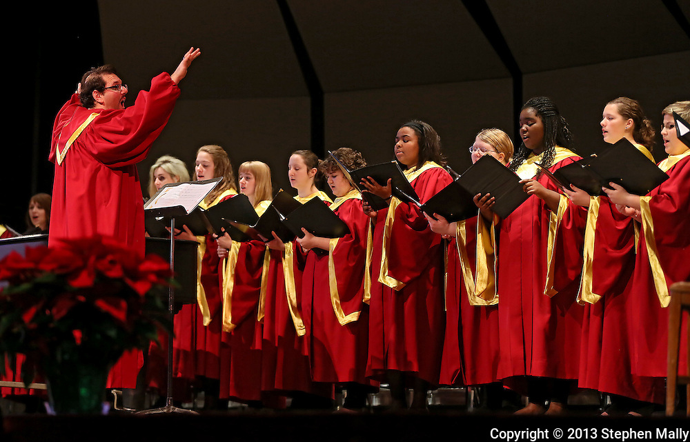 "Cameron Sullenberger (left) leads the Coe College Chorale as they sing ""Rise Up Shepherds and Follow"" during the Coe College Christmas Convocation at Sinclair Auditorium in Cedar Rapids on December 3, 2013. The convocation included songs by the Coe College Chorale, Concert Choir, and Handbell Ensemble, along with readings from the Bible."