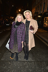 Left to right, CHRISTINE COYLE and her daughter NATALIE COYLE at the Quintessentially Foundation and The Crown Estate's Fayre of St.James' on 27th November 2014.  The evening started with a christmas concert at St.James's Church, Piccadilly.  Following the concert singer Leona Lewis switched on the Jermyn Street Christmas lights and then guests had a party at the newly refurbished Quaglino's, 16 Bury Street, London