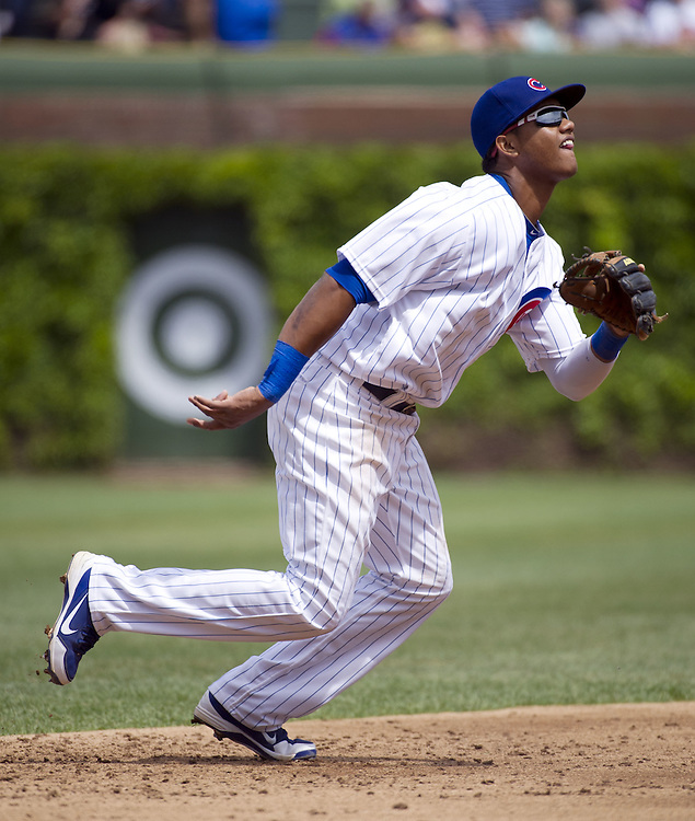 CHICAGO - MAY  04:  Starlin Castro #13 of the Chicago Cubs fields against the Los Angeles Dodgers on May 4, 2012 at Wrigley Field in Chicago, Illinois.  The Cubs defeated the Dodgers 5-4.  (Photo by Ron Vesely)   Subject:  Starlin Castro