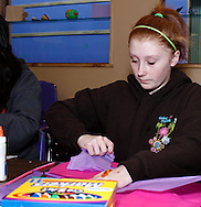 A Girl Scout works on a craft project during Program Aide (PA) training at the Girl Scouts urban campus in Dayton, Saturday, March 3, 2012.