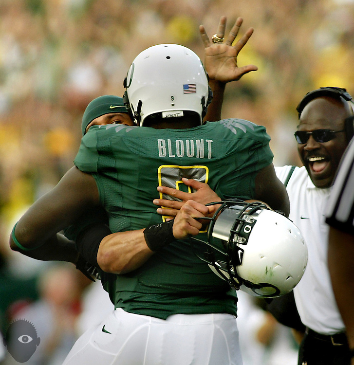 01/01/10  - Oregon's LeGarrette Blount (9) is hugged by teammate QB Jeremiah Masoli (8) after scoring a first half touchdown.
