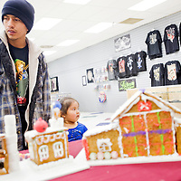 120412       Cable Hoover<br /> <br /> Shaun Vandever and his daughter Mileena Vandever and Suvannah Yazzie, right, look at the gingerbread houses on display during the Festival of Trees at the Rio West Mall Tuesday.
