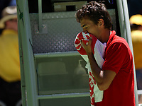 Tennis, MELBOURNE, AUSTRALIA - JANUARY 19:  John Van Lottum of Holland is distraught after losing his match against Gustavo Kuerten of Brazil during day one of the Australian Open January 19, 2004 in Melbourne, Australia