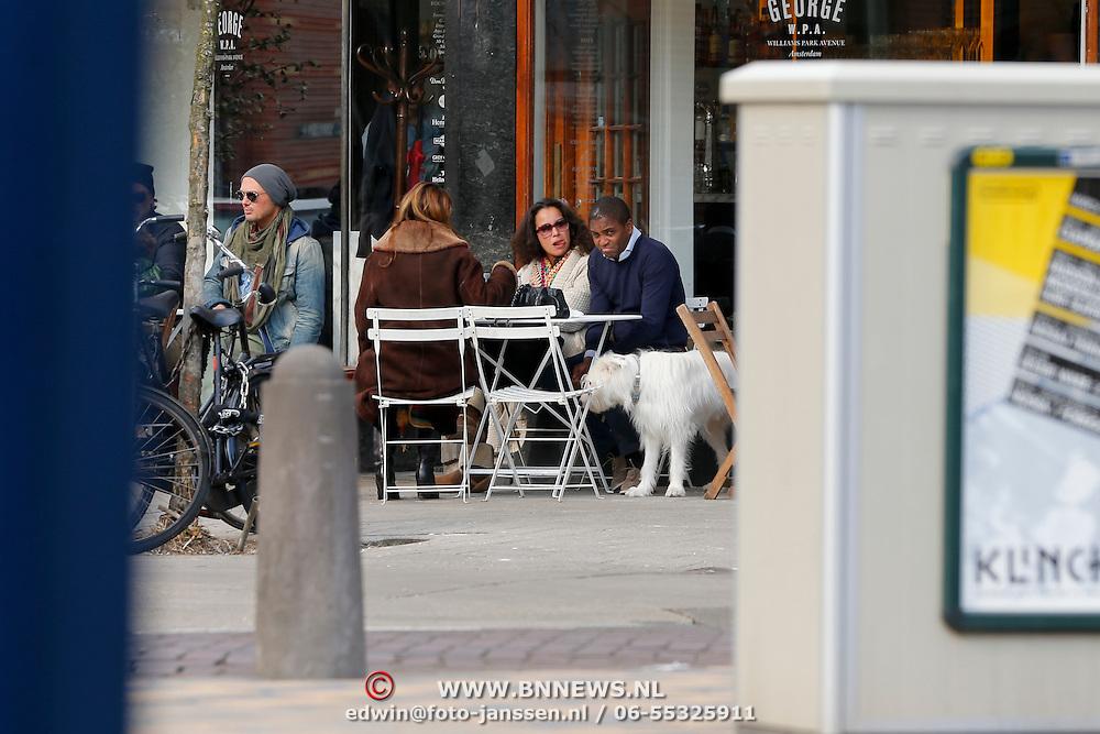 NLD/Amsterdam/20130330 - Oud voetballer Byan Roy en onbekende dame op een terras in Amsterdam,