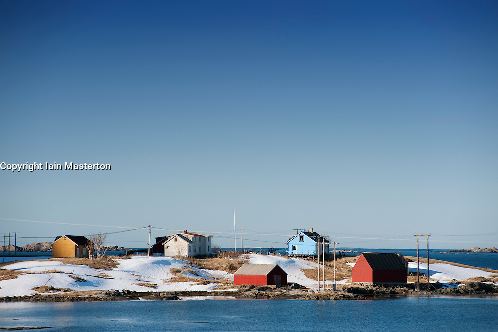 Brightly painted wooden houses by the sea in Eggum on Lofoten Islands in Norway
