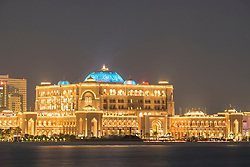 Exterior night view of luxury Emirates Palace Hotel in Abu Dhabi United Arab Emirates