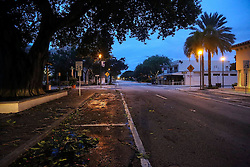 October 9, 2016 - Lake Worth, Florida, U.S. - It's not often Lucerne Avenue looks like a ghost town. The only thing missing were tumbleweeds. But deserted is how one of the city's main strips looked early Friday as Hurricane Matthew marched toward Palm Beach County. Despite a forecast for a devastating storm, the county got lucky and wasn't hit with Matthew's full wrath. Chances are Lucerne Avenue won't be that empty this week. (Credit Image: © Bruce R. Bennett/The Palm Beach Post via ZUMA Wire)