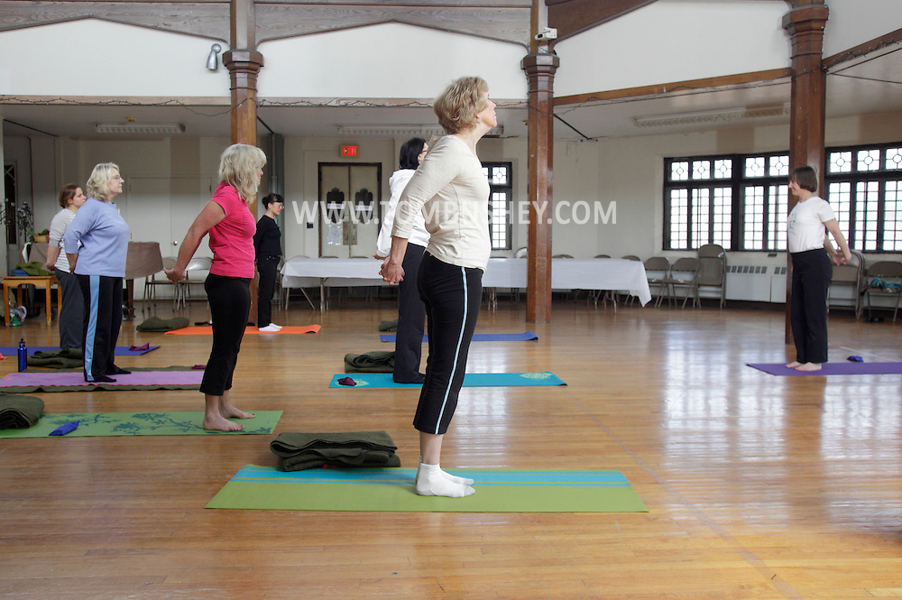 Middletown, New York - Women follow instructor Maria Blon, right, of Create Your Wellness, during a yoga class at the First Presbyterian Church on April 21, 2011.