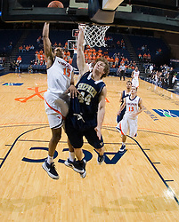 Virginia guard Sylven Landesberg (15) dunks over Shepherd guard Derek Gallagher (44).  The Virginia Cavaliers defeated the Shepherd Rams 87-52 in an NCAA basketball exhibition game at the University of Virginia's John Paul Jones Arena in Charlottesville, VA on November 9, 2008.