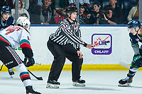 KELOWNA, BC - JANUARY 24: Line official Michael McGowan prepares to drop the puck between Alex Swetlikoff #17 of the Kelowna Rockets and Matthew Rempe #32 of the Seattle Thunderbirds at Prospera Place on January 24, 2020 in Kelowna, Canada. (Photo by Marissa Baecker/Shoot the Breeze)