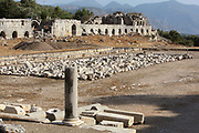 The Roman stadium seating 2500 people and the 150 long agora or market hall behind, in Tlos, a Lycian city in the Xanthos valley, Antalya, Turkey. These structures date from the 2nd century AD after an earthquake in 141 AD destroyed much of the city. Tlos was a major Lycian city from the 5th century BC, joining the Lycian Federation in the 2nd century BC. It was settled by the Greeks, Romans, Byzantines and finally the Ottoman Turks. Tlos has an agora, rock tombs and sarcophagi, a stadium, an acropolis, public bath, church and theatre, as well as the Ottoman residence of Ali Agha, governor of the region during the 19th century. Picture by Manuel Cohen