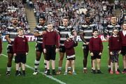 Hull FC players with match mascots before the Betfred Super League match between Hull FC and Leeds Rhinos at Kingston Communications Stadium, Hull, United Kingdom on 19 April 2018. Picture by Mick Atkins.