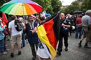 Frankfurt am Main | 04 Aug 2014<br /> <br /> Am Montag (04.08.2014) demonstrierten in Frankfurt am Main etwa 400 Menschen aus verschiedenen linken und linksradikalen Gruppen, aus der j&uuml;dischen Gemeinde und der Frankfurter Stadtgesellschaft gegen Antisemitismus und Judenhass. In den vergangenen Wochen war es in der Bankenstadt immer wieder zu antisemitischen Vorf&auml;llen wie Schmierereien an einer Synagoge, Hass-Kundgebungen oder einer eingeworfenen Scheibe bei einer j&uuml;dischen Familie und Beschimpfungen als &quot;Judenschweine&quot; gekommen.<br /> Hier: Eine Frau ist zu der Demo mit einer Flagge von Israel und einer Deutschen Flagge in schwarz-rot-gold, die an der selben Fahnenstange wie die israelische Flagge befestigt ist, erschienen. Sie wurde von den Organisatoren aufgefordert, die Kundgebung zu verlassen, da keine Fahne ausser der israelischen erw&uuml;nscht waren. Sie ist dann mit ihren beiden Flaggen hinter der Demo hergegangen.<br /> <br /> &copy;peter-juelich.com<br /> <br /> [No Model Release | No Property Release]