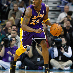 February 5, 2011; New Orleans, LA, USA; Los Angeles Lakers shooting guard Kobe Bryant (24) against the New Orleans Hornets during the fourth quarter at the New Orleans Arena. The Lakers defeated the Hornets 101-95.  Mandatory Credit: Derick E. Hingle