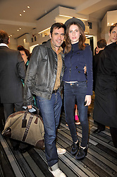 ROLAND MOURET and TALI LENNOX at the opening party for Nicholas Kirkwood's new store at 5 Mount Street, London on 12th May 2011.