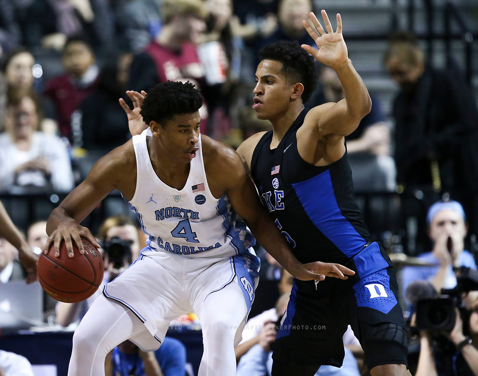 North Carolina forward Isaiah Hicks (4) posts up against Duke guard Frank Jackson (15) during the semifinals of the 2017 New York Life ACC Tournament at the Barclays Center in Brooklyn, N.Y., Friday, March 10, 2017. (Photo by David Welker, theACC.com)