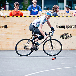 London, UK - 24 August 2012: people watch one of the players during the Hell's Belles Vol 2, Ladies Bike Polo Tournament in Bethnal Green Gardens.