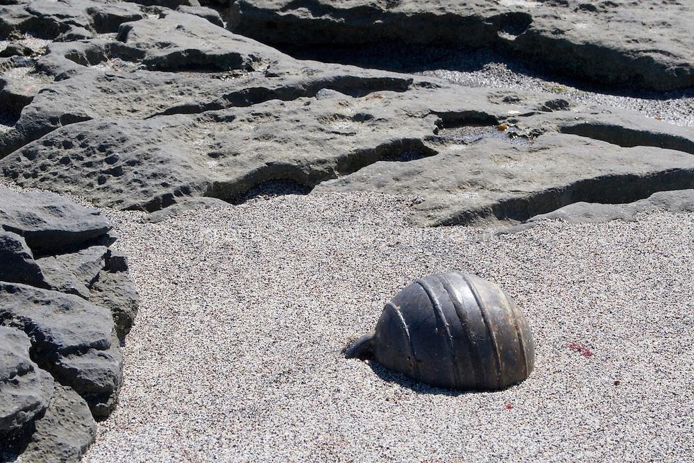 Bouy half burried in sand on limestone rocks on Inis Oirr Island the Aran Islands County Galway Ireland
