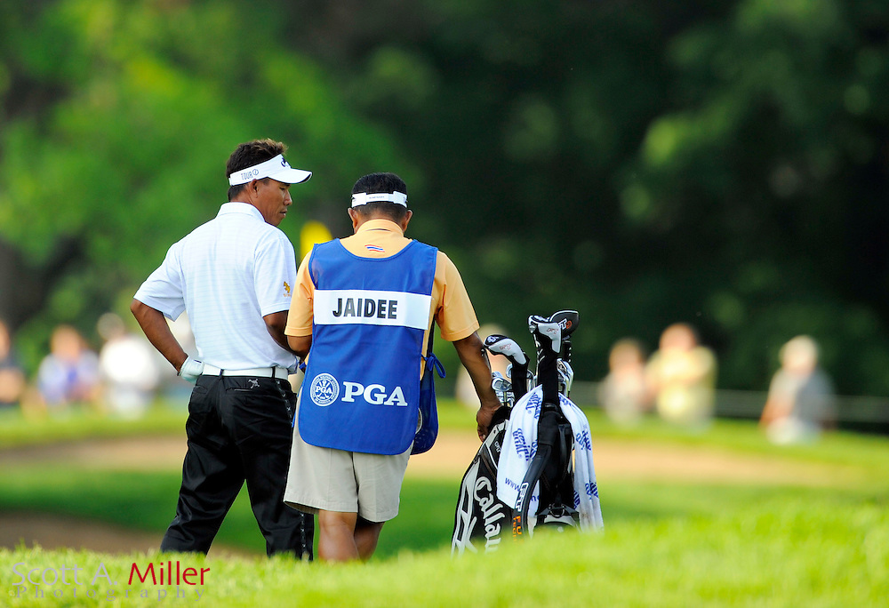 Aug 13, 2009; Chaska, MN, USA; Thongchai Jaidee talks with his caddie during the first round of the 2009 PGA Championship at Hazeltine National Golf Club.  ©2009 Scott A. Miller