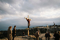 """MATERA, ITALY -6 OCTOBER 2019: The backstage of the scene of the crucifixion of Jesus Christ is seen here during the production of """"The New Gospel"""", a film by Swiss theatre director Milo Rau, in Matera, Italy, on October 6th 2019.<br /> <br /> Theatre Director Milo Rau filmed the Passion of the Christ  under the title """"The New Gospel"""" with a cast of refugees, activists and former actors from Pasolini and Mel Gibson's films.<br /> <br /> The role of Jesus is performed by Yvan Sagnet, a Political activist born in Cameroon and who worked on a tomato farm when in 2011 he revolted against the system of exploitation and led the first farm workers' strike in southern Italy. In a series of public shoots in the European Capital of Culture Matera, Jesus will proclaimed the Word of God, was crucified (October 6th 2019) and finally rose from the dead in Rome, the capital of Catholic Christianity and seat of one of the most xenophobic governments in Europe (October 10th 2019).<br />  <br /> Parallel to the film, the humanistic message of the New Testament was transformed into the present: at the beginning of September, the campaign """"Rivolta della Dignità"""" (Revolt of Dignity), which demanded fair working and living conditions     for refugees, global freedom of travel and civil rights for all, started with a march from the southern Italian refugee camps. """"It's about putting Jesus on his feet,"""" director Milo Rau said. Led by Jesus actor Yvan Sagnet, the campaign fights for the rights of migrants who came to Europe via the Mediterranean to be enslaved by the Mafia in the tomato fields of southern Italy and to live in ghettos under inhumane conditions. The campaign and the film thus create a """"New Gospel"""" for the 21st century, a manifesto of solidarity with the poorest, a revolt for a more just and humane world."""
