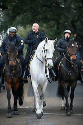 04 March 2014. New Orleans, Louisiana.<br /> Mayor Mitch Landrieu rides a horse ahead of the main early morning Krewe of Zulu parade.<br /> Photo; Charlie Varley/varleypix.com