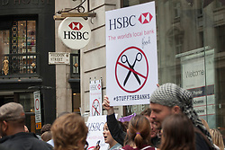 © licensed to London News Pictures. London, UK 20/07/2013. UK Uncut protesters staging a protest over welfare spending cuts outside a HSBC branch on Regent Street, London on Saturday, 20 July 2013. Photo credit: Tolga Akmen/LNP