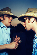 Two men wearing shirts and cowboy hats, smoking, Homelands, U.K 1999.