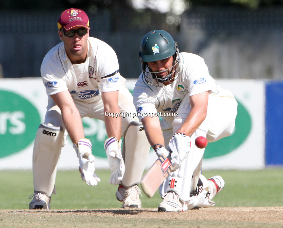 Central's Mathew Sinclair plays a shot in front of Northerns Pete McGlashan in the teams Plunket Shield cricket match at Nelson Park, Napier, New Zealand. Wednesday 28 March, 2012. Photo: John Cowpland / phtosport.co.nz