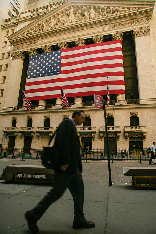 A man passes in front of New York Stock Exchange.