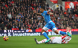 Ryan Shawcross of Stoke City tackles Callum Wilson of Bournemouth (L) - Mandatory by-line: Jack Phillips/JMP - 19/11/2016 - FOOTBALL - Bet365 Stadium - Stoke-on-Trent, England - Stoke City v Bournemouth - Premier League