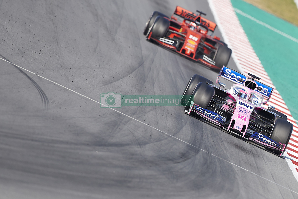 February 28, 2019 - Spain - Lance Stroll (Racing Point F1 Team) RP19 car and Charles Leclerc (Scuderia Ferrari Mission Winnow) SF90 car are seen in action during the winter testing days at the Circuit de Catalunya in Montmelo  (Credit Image: © Fernando Pidal/SOPA Images via ZUMA Wire)