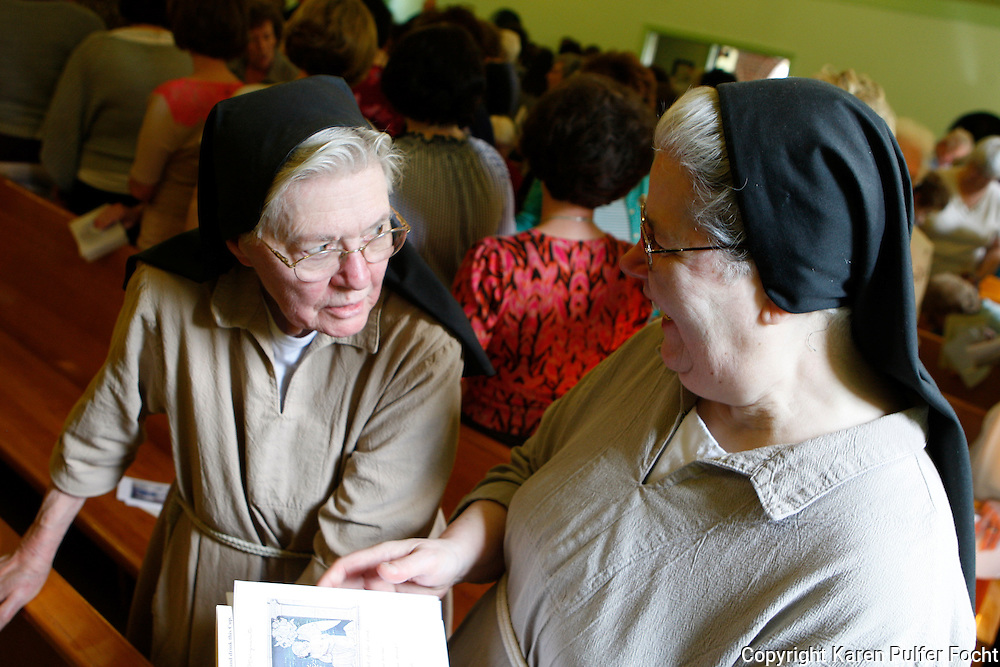 Sister John (left), an aging cloistered Poor Clare Nun from Memphis, Tennessee,  speaks with sister Margurite. The number of Poor Clare nuns in Memphis is dwindling. They are a community of Catholic women who have chosen to embrace the way of life proposed by a young Italian girl in Assisi over 800 years ago.