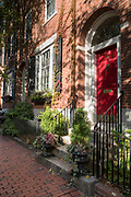 Stylish period property with red front door in Brimmer Street in the Beacon Hill district of Boston, USA
