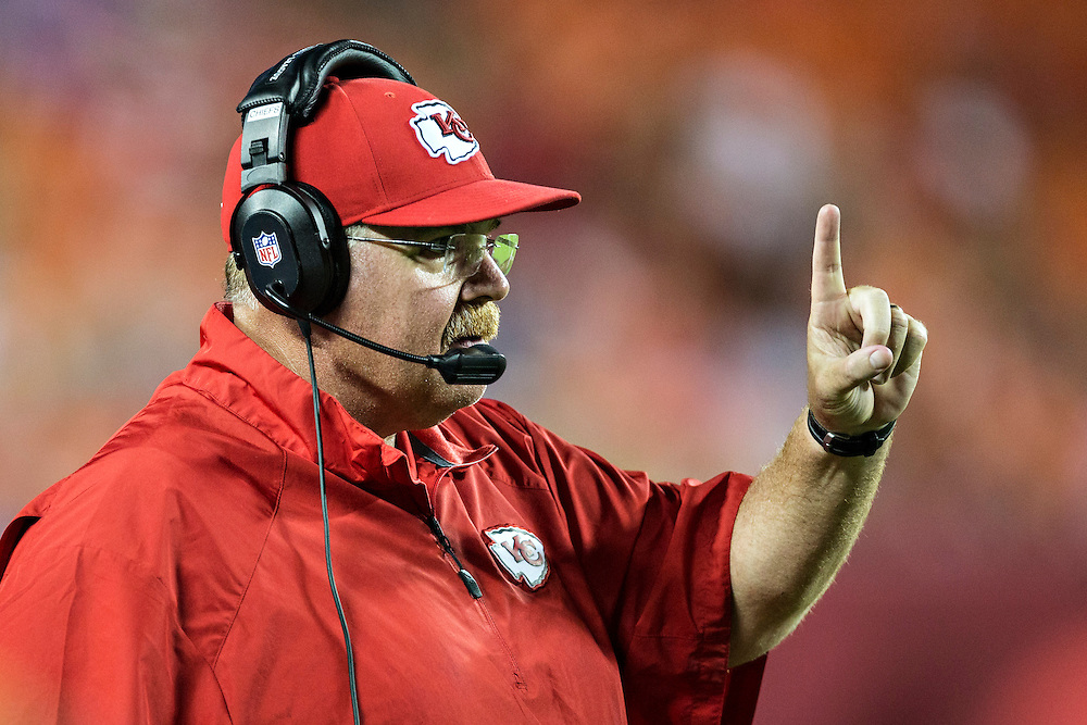 KANSAS CITY, MO - AUGUST 29:  Head Coach Andy Reid of the Kansas City Chiefs signals first down to the officials during the last preseason game against the Green Bay Packers at Arrowhead Stadium on August 29, 2013 in Kansas CIty, Missouri.  (Photo by Wesley Hitt/Getty Images) *** Local Caption *** Andy Reid