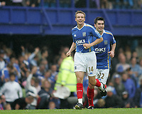 Photo: Lee Earle.<br /> Portsmouth v Bolton Wanderers. The FA Barclays Premiership. 18/08/2007.Portsmouth's Matthew Taylor (L) celebrates after scoring their third goal.