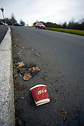 Discarded McDonald's coffee cup, in the Phoenix Park, Dublin, Ireland. ..In a recent survey done in the UK by Keep Britain Tidy in January, McDonald's packaging accounted for 29% of all fast food litter. However, as this image shows, the problem isn't confined to the United Kingdom.