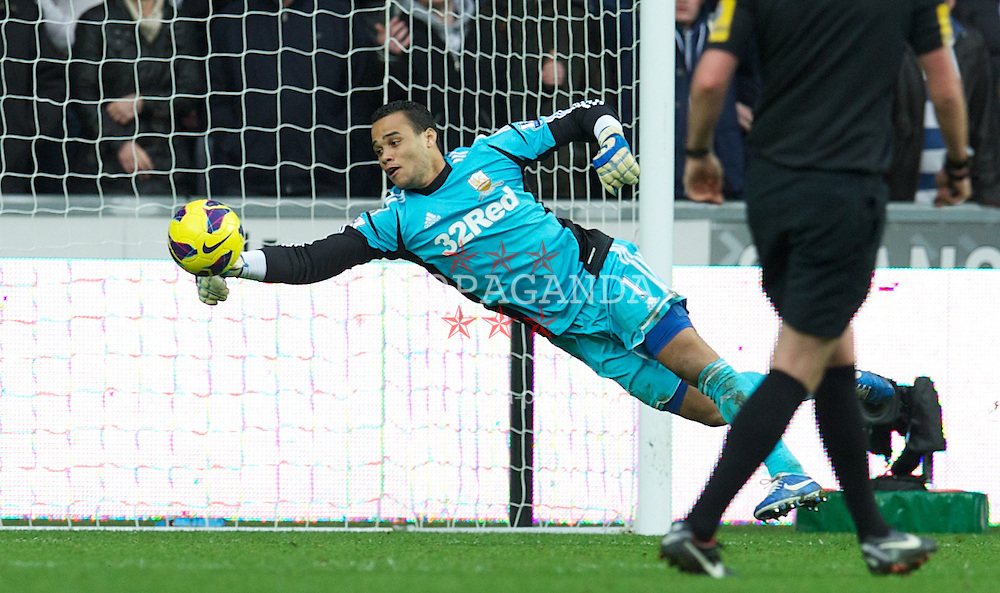 SWANSEA, WALES - Sunday, December 23, 2012: Swansea City's goalkeeper Michael Vorm makes a save during the Premiership match against Manchester United at the Liberty Stadium. (Pic by David Rawcliffe/Propaganda)