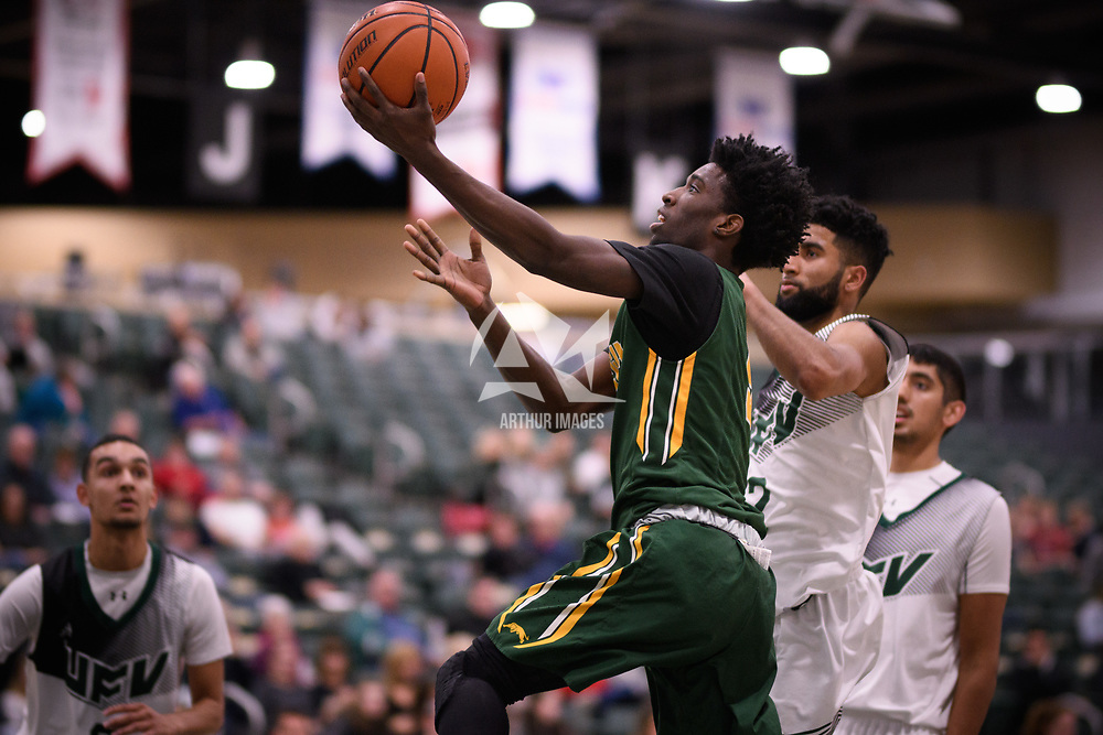 3rd year forward Shaquille Harris (6) of the Regina Cougars during the Men's Basketball home game on November 11 at Centre for Kinesiology, Health and Sport. Credit: Arthur Ward/Arthur Images