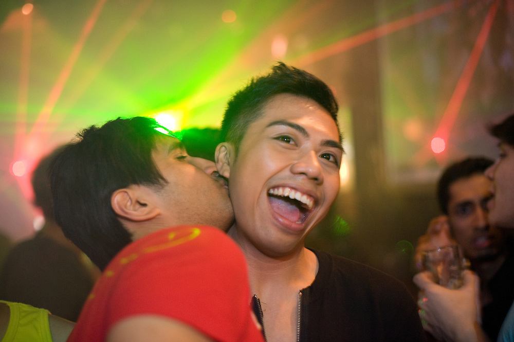 Guy kissing a friend in Tantric/ Singapore