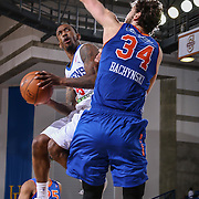 Delaware 87ers Guard RUSS SMITH (5) drive to the basket as Westchester Knicks Center JORDAN BACHYNSKI (34) defends in the second half of a NBA D-league regular season basketball game between the Delaware 87ers and the Westchester Knicks Tuesday, JAN, 19, 2016 at The Bob Carpenter Sports Convocation Center in Newark, DEL