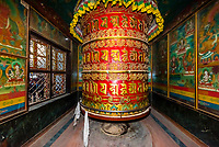 A massive prayer wheel at the Boudhanath Temple. It is the largest stupa in Nepal and the holiest Tibetan Buddhist temple outside Tibet. It is the center of Tibetan culture in Kathmandu, Nepal.