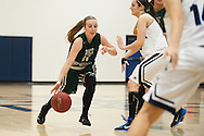 Rice guard Jordan Lawrence (11) drives to the hoop during the girls basketball game between the Rice Green knights and the Mount Mansfield Cougars at MMU High School on Friday night December 4, 2015 in Jericho. (BRIAN JENKINS/for the FREE PRESS)