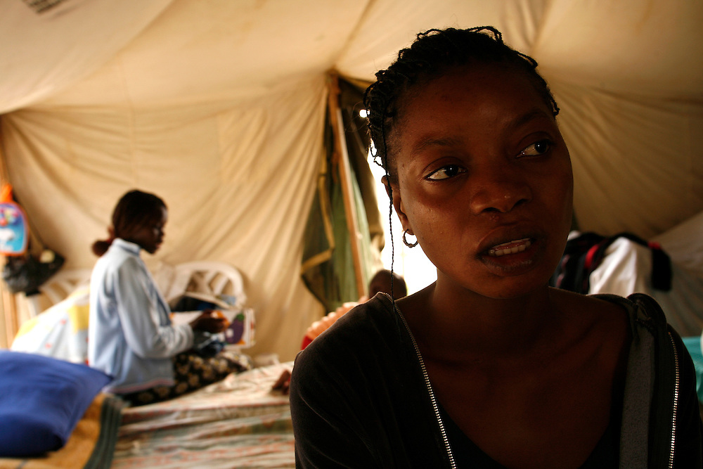Agnes Sgmons 25 refugees from south Sudan in the tent that she sharing with other five woman and there children in the detention center in Qeziot, Israel..Monday November 12. 2007....Kalamin Charles Goda and Agnes Sgmons are a young couple that escaped the conflict in south Sudan region and sought refuge in Egypt in 2006...While the couple waited to have their refugee status processed, they struggled in Cairo. They received no financial assistance and were unable to work. Without a work permit, Agnes brought in about 300 Egyptian pounds a month (about $54). Desperate, the couple risked another dangerous move ? slipping across the border to Israel in the hopes they would gain their refugee status there and either stay and work in Israel or be relocated to the U.S...With the help of a Bedouin smuggler, the couple crossed the Sinai desert. Close to the border, they encountered Egyptian troops, who they say shot at them. Under fire, they ran for the Israeli border, having been told Israeli troops would protect them...Once in Israel, the couples were captured by an Israeli army patrol, who deposited them at a detention center in Qeziot, in southern Israel. Given hot food and clothing, Kalamin and Agnes were both interviewed by the UN, but were lodged in separate camps for men and women for several weeks before they saw each other again...During that time, doctors at a hospital in the Israeli city of Beer Sheva told Agnes she was four months pregnant. Kalamin had been given the news, but had not seen his wife for two weeks, since they arrived at the camp. Before leaving to meet her, he grabs a spare blanket, the only gift he can come up with to bring her...