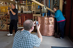 Corey Smith of Nashville makes a photo of his wife Stephanie during a tour of the Four Roses Bourbon distillery Tuesday, Oct. 5, 2010. Photo by Jonathan Palmer