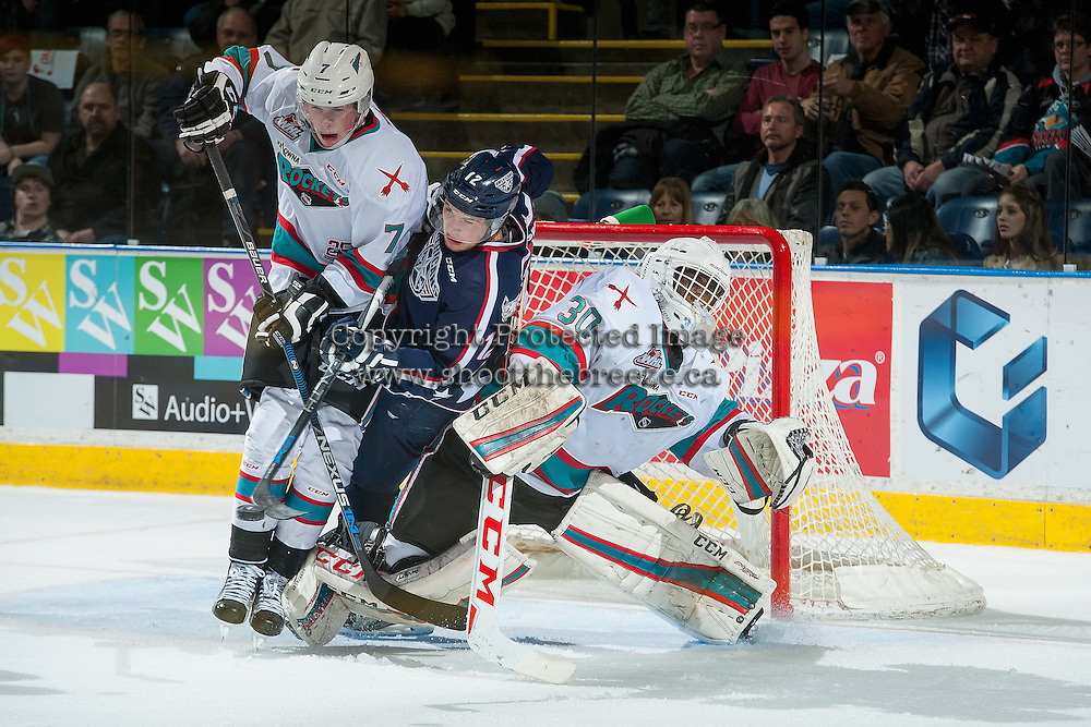 KELOWNA, CANADA - JANUARY 9: Jordan Topping #12 of Tri City Americans is checked by Lucas Johansen #7 in front of the net of Michael Herringer #30 of Kelowna Rockets on January 9, 2016 at Prospera Place in Kelowna, British Columbia, Canada.  (Photo by Marissa Baecker/Shoot the Breeze)  *** Local Caption *** Michael Herringer; Lucas Johansen; Jordan Topping;