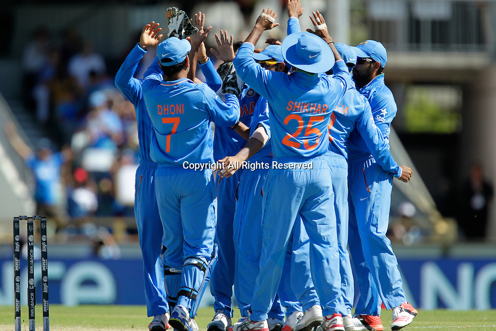 06.03.2015. Perth, Australia. ICC Cricket World Cup. India versus West Indies. Indian players celebrate the wicket of Dwayne Smith for 6.