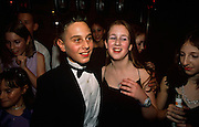 13 year-old Adam leader celebrates his Bar Mitzvah by holding a lavish party in Borehamwood in north London, England. Paid for by his parents, the celebration took place in a hotel off the A1 road and here Adam can be seen surrounded like a celebrity by a gaggle of teenage girl friends, one of whom is dressed in a thin-strapped dress and pendant, giggling at a joke and all enjoying the occasion. Adam looks dashing in a rented dinner jacket complete with bow-tie. He is fresh-faced and clean-cut, cutting a handsome figure much-admired by his female friends. .