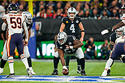 Derek Carr (QB) of the Oakland Raiders  about to take the snap from Rodney Hudson (C) of the Oakland Raiders during the International Series match between Oakland Raiders and Chicago Bears at Tottenham Hotspur Stadium, London, United Kingdom on 6 October 2019.