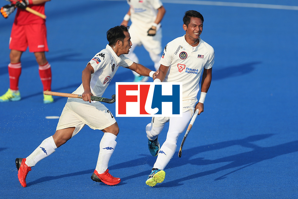LONDON, ENGLAND - JUNE 19:  Izad Jamaluddin of Malaysia celebrates scoring his teams first goal during the Pool A match between South Korea and Malaysia on day five of Hero Hockey World League Semi-Final at Lee Valley Hockey and Tennis Centre on June 19, 2017 in London, England.  (Photo by Alex Morton/Getty Images)