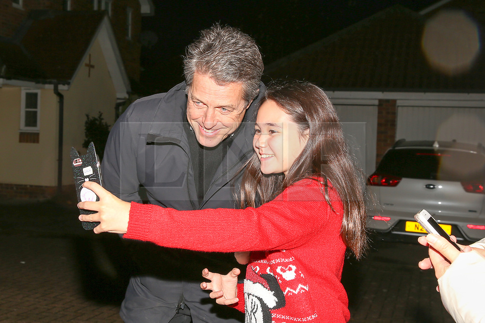 © Licensed to London News Pictures. 01/12/2019. London, UK. A fan of actor and film producer HUGH GRANT takes a selfie as he joins Liberal Democrats' parliamentary candidate for Finchley & Golders Green, LUCIANA BERGER during canvassing in Finchley, North London, to bid to stop a Conservative majority and Stop Brexit. Photo credit: Dinendra Haria/LNP